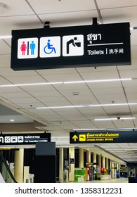 Bangkok, Thailand - Mar 11, 2019 : Signpost to the toilet for people and Disabled person in Don Mueang International Airport at night.Signpost to the bathroom for wash hands and face in the airport