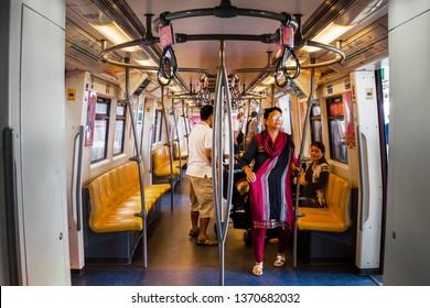 BANGKOK, THAILAND - MAR 25 : People inside BTS Skytrain on March 25, 2019 in Bangkok. Bangkok Skytrain has been designed to hep people travel around Bangkok easily.