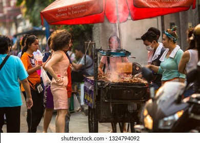 BANGKOK, THAILAND - MAR 30, 2016: Street food, a lively trade in one of the Central areas of the city. There is 16,000 registered street vendors in Bangkok.