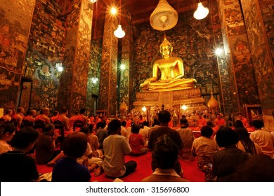 BANGKOK, THAILAND - MAR 31: Unidentified buddhist monks and People Praying at Wat Suthat Thepwararam on March 31, 2012 in Bangkok, Thailand. It is the respect and esteem of the people of Bangkok