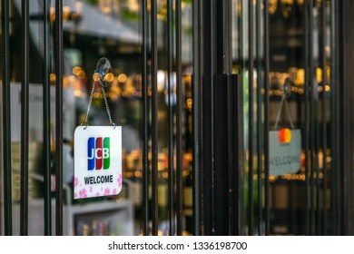 Bangkok, Thailand - March 03, 2019: JCB credit cards and welcome sign hangs in front of a shopping store in in Bangkok, Thailand. JCB is a credit card company based in Tokyo Japan.