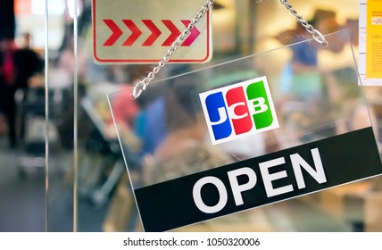 BANGKOK, THAILAND - MARCH 04: JCB credit cards accepted sign hangs in front of a restaurant in The Mall Bangkhae in Bangkok on March 04, 2018. JCB is a credit card company based in Tokyo Japan.