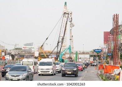 "Bangkok, Thailand - March 06 2018:Cralwer crane and other equipment on jobsite to construct mass rapid transit of Thailand or MRT orange line (East Section).To build Mrt Station ""Klong Ban Ma""."