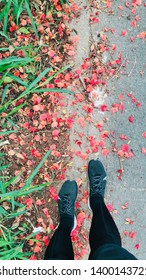 BANGKOK, THAILAND, MARCH 07, 2019: The runner wears the black running shoes of NIKE Zoom Fly FK, stands on the street which flowers dropped.