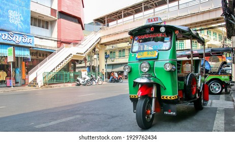 Bangkok, Thailand : March 1, 2021 - Tuk-Tuk car or 3 wheeler taxi is waiting for passengers to service on the roadside.