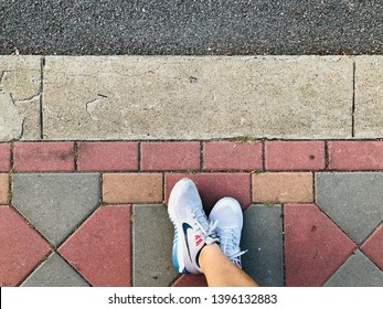 BANGKOK, THAILAND, MARCH 10, 2019: The runner wears the light grey stability running shoes of NIKE which models is Nike Air Zoom Structure 21.