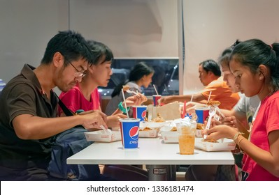 BANGKOK, THAILAND - MARCH 10: Unidentified dinners drinks Pepsi Cola while dinning in KFC on Petchkasem 69 in Bangkok on March 10, 2019.