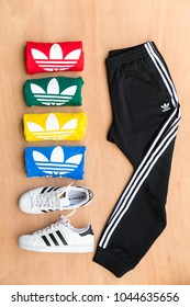 BANGKOK, THAILAND - MARCH 11, 2018: Original t shirt Trefoil Tee Adicolor, SST Track Pants New Collection 2018 for men and Adidas original superstar  white/black shoes on wooden