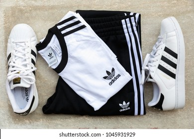 BANGKOK, THAILAND - MARCH 11, 2018: Original t shirt 3-Stripes Tee and SST Track Pants New Collection 2018 for men and Adidas original superstar  white/black shoes