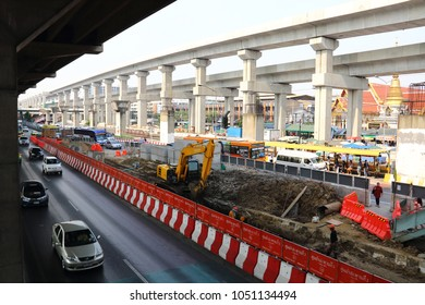 Bangkok, Thailand – March 11 2018: Foreman make way at 24 kilometers of the Vibhavadi Rangsit road for the construction of a new Thai airport access bridge.
