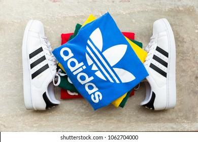 BANGKOK, THAILAND - MARCH 11, 2018: Original t shirt Trefoil Tee Adicolor New Collection 2018 for men and Adidas original superstar  white/black shoes