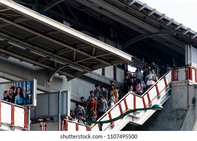 BANGKOK, THAILAND - MARCH 11, 2018: people descending from the BTS station in Bangkok