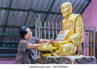 Bangkok, Thailand - March 11, 2019 : Unidentified Thai buddhism people in buddhist pray for benefaction worship by incense and garland to Buddha or spirit-house at shrine or Thai temple (Wat Thai)