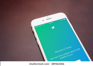BANGKOK ,THAILAND - MARCH 12, 2016 : Apple iPhone 6 open Twitter application showing on mobile screen, is an online social networking and service that enables users to send and read message