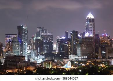 Bangkok Thailand - March 12, 2016 : Cityscape Modern building and Skyline of North Sukhumvit Bangkok over Lumpini park at night