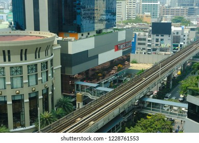 Bangkok, Thailand - March 12, 2018: cityscape of modern office building & railway of BTS sky train mass transit system in Asoke-Sukhumvit area in Bangkok, Thailand on March 12, 2018