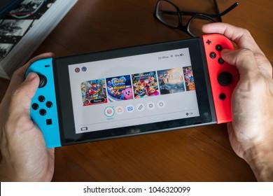Bangkok, Thailand - March 13, 2018 : A man playing Nintendo Switch.