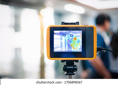 Bangkok, Thailand - March 13, 2020 : Unidentified people waiting body temperature check to access building for against epidemic flu covid19 or corona virus by thermoscan or infrared thermal camera