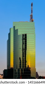BANGKOK, THAILAND - MARCH 13 : CAT Telecom building with sunset reflection on glass facades on 13 March 2019 in Bangkok, Thailand