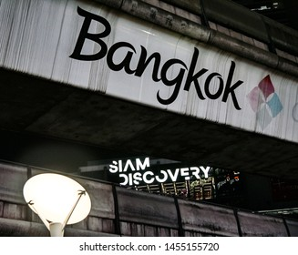 BANGKOK, THAILAND - MARCH 13 : Siam Discovery text at facade with Bangkok text at sky trail railway structureon 13 March 2019 in Bangkok, Thailand