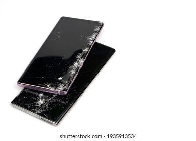 Bangkok, Thailand: March 14, 2021 - Close-up of a Samsung Galaxy Note isolated on a white background, it fell and the screen was cracked.