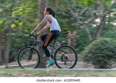Bangkok, Thailand - March 15, 2017 : Unidentified people riding a bicycle by cycling on a bicycle lane in a outdoor park for exercise healthy