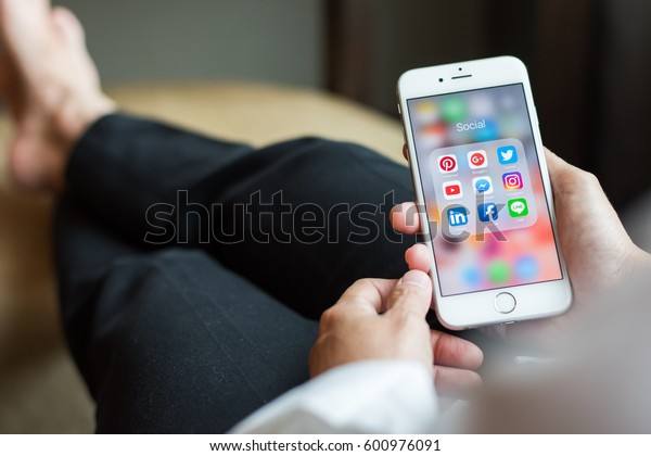 BANGKOK, THAILAND - March 15, 2017: Social media app icons on Iphone7 screen smartphone with mobile internet technology in digital lifestyle.
