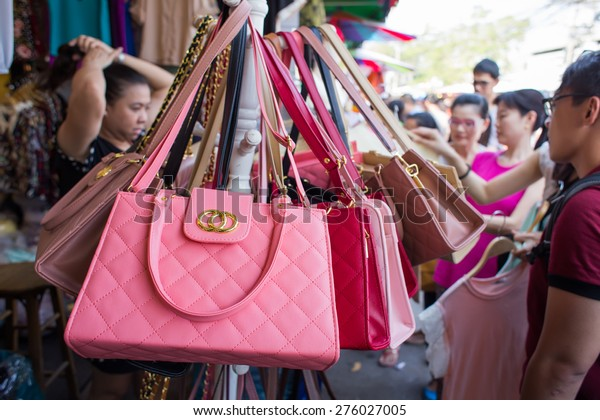 BANGKOK, THAILAND - MARCH 15 : Fake handbags on display at Jatujak or Chatuchak Market on March 15, 2015 in Bangkok, Thailand. Jatujak Market is the largest market in Thailand.