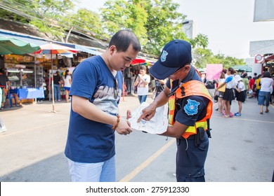 BANGKOK, THAILAND - MARCH 15 : Unidentified officer gives direction advice to tourist at Jatujak Market on March 15, 2015 in Bangkok, Thailand. Jatujak Market is the largest market in Thailand.