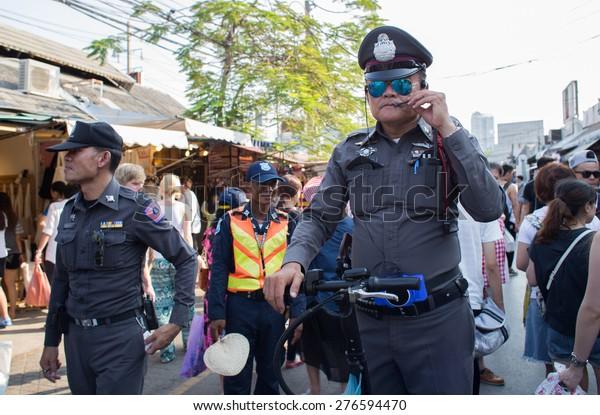 BANGKOK, THAILAND - MARCH 15 : Unidentified Thai police drives Onlywheel at Jatujak or Chatuchak Market on March 15, 2015 in Bangkok, Thailand. Jatujak Market is the largest market in Thailand.