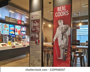 Bangkok, Thailand - March 16,2019 : KFC drive thru on Ramintra Rd., Opposite Synphaet Hospital. KFC is a fast food restaurant chain that specializes in fried chicken