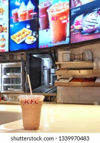 Bangkok, Thailand - March 16,2019 : KFC drive thru on Ramintra Rd., Opposite Synphaet Hospital. KFC is a fast food restaurant chain that specializes in fried chicken.Sell cocoa malt drinks.