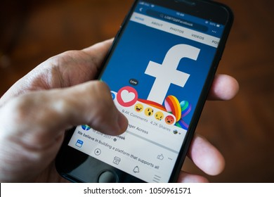 Bangkok, Thailand - March 17, 2018 : Facebook user touch on love button in Facebook application on iPhone 7.