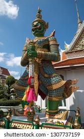 BANGKOK, THAILAND - March 17, 2018 : Yak, iconic giant demons guarding the gate to the temple of Wat Arun Rajwararam (Temple of Dawn).