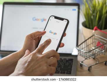 Bangkok, Thailand - March 17, 2018: Google application with voice speaker typing, intelligent search engine sign up page on mobile app touchscreen on iphone and on computer screen display