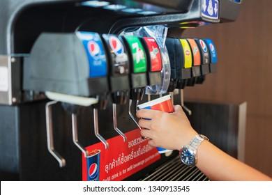 BANGKOK THAILAND - March 17, 2019: Counter Electric Beverage soda fountain system machine or Pepsi' s soft drink dispenser at KFC restaurant in Bangkok , selective focus