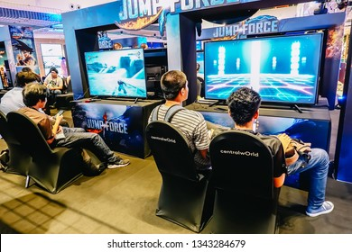 Bangkok, Thailand - March 17, 2019: People play to Playstation 4 videogames at event Festival on March 17, 2019 in Bangkok, Thailand.