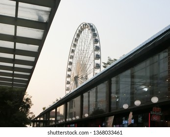 BANGKOK, THAILAND - MARCH 17, 2019: The retail shops and retro ferris wheel and blue sky background in an amusement park at Asiatique the riverfront.