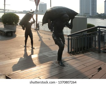BANGKOK, THAILAND - MARCH 17, 2019: The statue at The Asiatique the riverfront featuring the past story of the place.