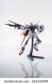 BANGKOK, THAILAND - MARCH 18, 2015: Plastic model of GAT-X105+AQM/E-X01 Aile Strike Gundam over white background.