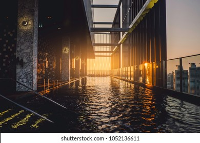 Bangkok, Thailand - March 18 2018:  Luxury pool on 50th floor, one of several amenities in Park24 urban style condominium during sunset