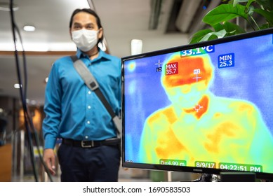 Bangkok, Thailand - March 18, 2020 : Unidentified people waiting body temperature check to access building for against epidemic flu covid19 or corona virus by thermoscan or infrared thermal camera