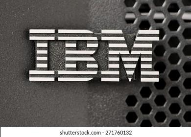 Bangkok, Thailand - March 19, 2015: Closeup of silver IBM logo over huge pSeries server black color rack lid mesh