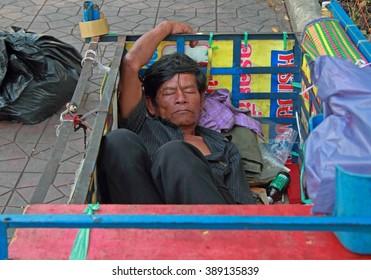 BANGKOK, THAILAND - MARCH 19 2015: man is sleeping in trailor body, Bangkok, Thailand