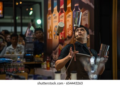 Bangkok, Thailand - March 19, 2017 : Unidentified bartender or barman mixing a drink for show and service at restaurant