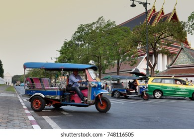 BANGKOK - THAILAND - MARCH 20, 2016-  Tuk Tuk Car, , Traditional transport in Thailand. Inexpensive and fast means of transportation in the city.