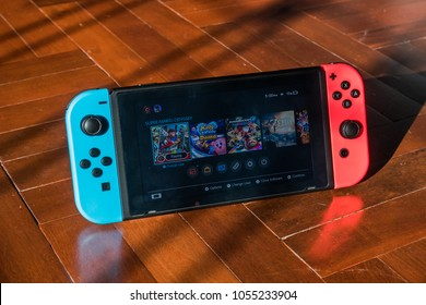Bangkok, Thailand - March 20, 2018 : Nintendo Switch, the video game console on wooden floor.