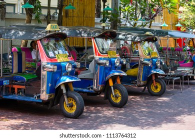BANGKOK, THAILAND - MARCH 20, 2018 : Auto rickshaw or tuk-tuk on the street of Bangkok, Thailand. Tuk tuks are commonly used in transporting people and goods around the capital