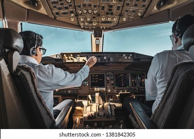 Bangkok, Thailand - March 20, 2019. Boeing 777 Aircraft cockpit view with two working pilots.