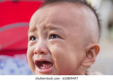 Bangkok, Thailand - March, 20: Unidentified baby screaming on the Street in Bangkok, Thailand, March 20 2017